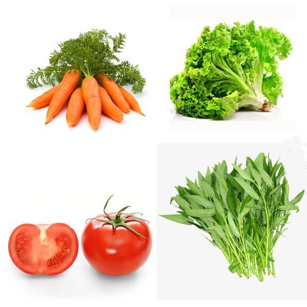 Thức ăn phụ cho gà đá mau mập bao gồm rau xanh, cà chua, cà rốt.